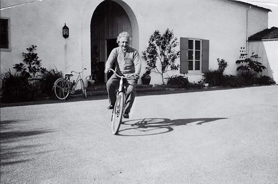 Albert Einstein Riding a Bike